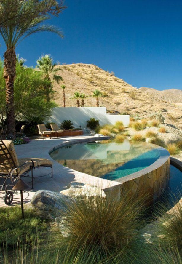Home pool built into the desert hillside.  Totally reminds me of AZ.