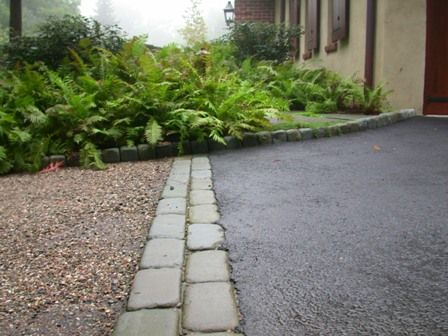 gravel driveway with shrubs for privacy | Peagravel and Asphalt Driveway