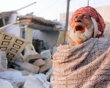 A man weeps infront of his destroyed house January 29, 2001 in Bhuj, India. Bhuj and the surrounding villages in the western indian state of Gujarat lay at the epicenter of Friday's earthquake, which registered 7.9 on the Richter scale, and few structures remain standing amidst the rubble.
