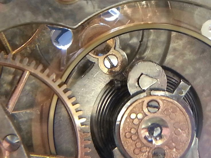 This is another Elgin Veritas ,  grade 376 , 16 size, 23 jewels, made about  1912 .      Here are some d etails showing the motor barrel , a...