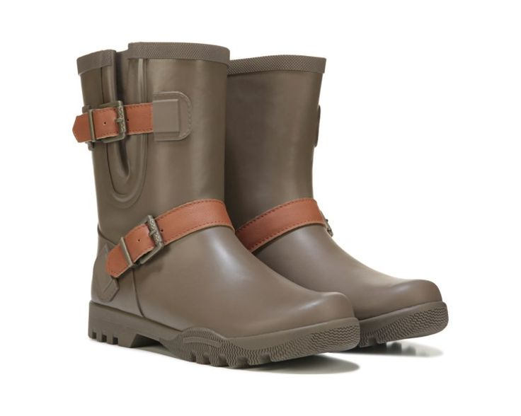 Buckle up and stay dry in the Nellie Lou Rain Boot from Sperry Top-Sider.Rubber upper in a rain boot style with a round toeStrap and buckle detailPull on entryBreathable fleece lining, cushioning insoleNon-marking rubber outsole