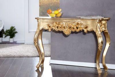 Qubo-Design Konsole LOUIS Gold 110cm  Die barocke Konsole LOUIS wird Sie begeistern. Die fein gearbeiteten Aplikationen in einem extravaganten barocken König LOUIS Stil zeigen die besondere Wertigkeit dieser Konsole.  Sie können diesen goldenen Konsolentisch als Ablagetisch für Schlüssel und Magazine in Ihrem Flur oder der Diele, als exklusives Möbel in Ihrem Wohnzimmer oder als gelunges Accessoire in Ihrem Empfangsbereich nutzen.