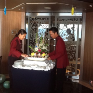 Holland America employees delivering Denises birthday cake at her