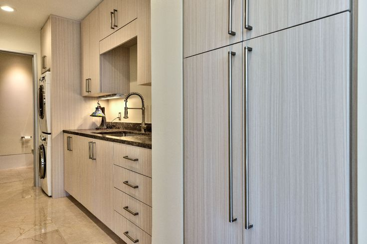 A Small Laundry Room Takes On Massive Space Saving Style