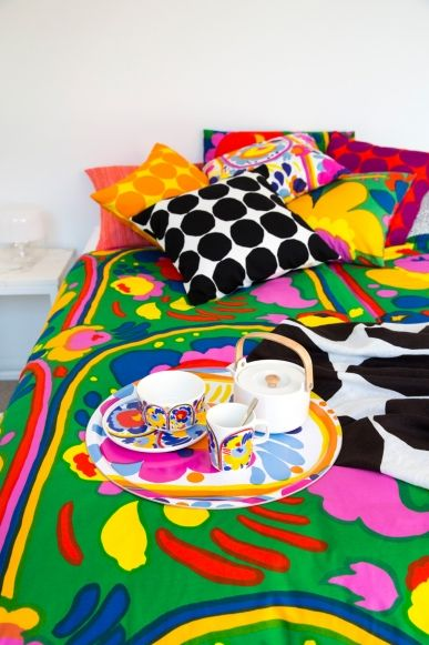 An airy Sydney home bursting with colour and print: Karuselli duvet cover with Pienet Kivet, Karuselli & Piene Jaruselli cushion covers plus Kivet interior cloth. On bed, Oiva and Karuselli accessories with Oiva teapot.