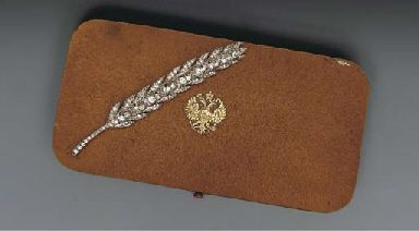 A diamond and platinum Imperial presentation brooch by Fabergé, workmaster August Holmström, St. Petersburg, circa 1890. Formed as a wheat spray, set with old-cut diamonds. Purchased by the Imperial Cabinet for 1,000 rubles and given on July 28, 1896 to Baron Monson on behalf of Emperor Nicholas II.