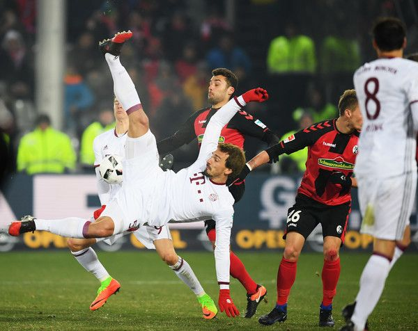Mats Hummels Photos Photos - Mats Hummels of Muechen attempts an overhead kick during the Bundesliga match between SC Freiburg and Bayern Muenchen at Schwarzwald-Stadion on January 20, 2017 in Freiburg im Breisgau, Germany. - SC Freiburg v Bayern Muenchen - Bundesliga