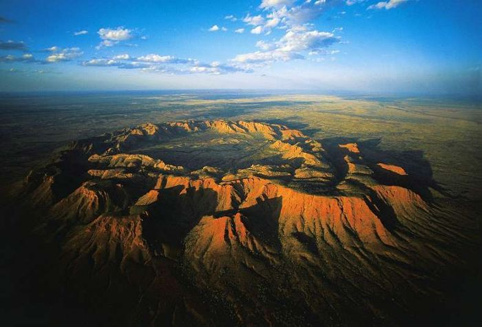 Vredefort Dome, approximately 120 km south-west of Johannesburg, is a representative part of a larger meteorite impact structure, or astrobleme. Dating back 2,023 million years, it is the oldest astrobleme yet found on Earth. With a radius of 190 km, it is also the largest and the most deeply eroded. Vredefort Dome bears witness to the world's greatest known single energy release event, which had devastating global effects including, according to some scientists, major evolutionary changes.