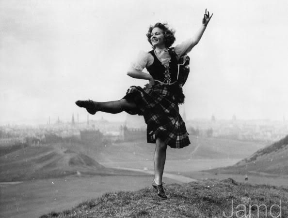 7th May 1955: Scotland's famous teacher of highland dancing, Miss Jean Reynolds, models the new Aboyne design of dress put forward by the Scottish Official Board of Highland Dancing.