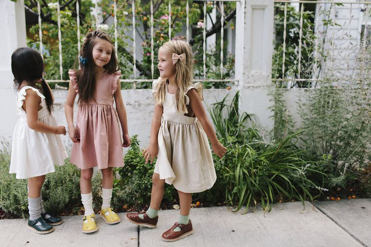 The Wren & James linen pinafore dresses in Ivory, Dusty Rose and Natural.