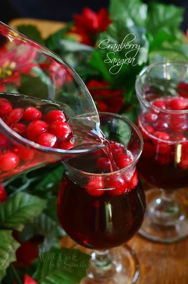 Cranberry Sangria is perfect for this holiday season. Delicious seasonal cocktail made with fresh cranberries, cranberry flavored vodka, juice and red wine.| from willcookforsmiles.com