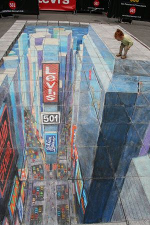 Times Square in Times Square. Julian Beever's artwork using chalk on the sidewalk. Amazing.