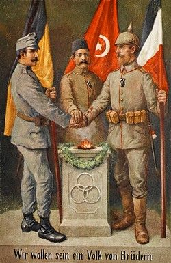 The Central Powers in World War One. Austri-Hungary, Turkey and Germany. Soldiers from each country stand before their flags and join hands in a show of unity. The German flag has, however been printed in error with the colouration of the French flag! ©Yooniq