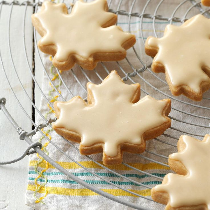 Glazed Maple Shortbread Cookies Recipe -Whenever I visit friends in Lutsen, Minnesota, I make sure to buy maple syrup there because I think it's even better than in Quebec. These delicious cookies can be decorated with sprinkles or they're just fine as is.—Lorraine Caland, Shuniah, Ontario