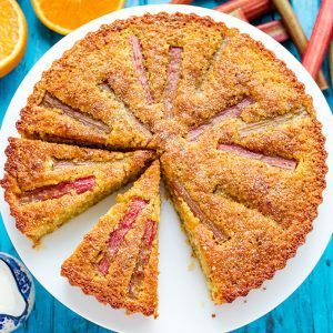A moist, orange-infused almond cake with juicy rhubarb and amaretto cream.