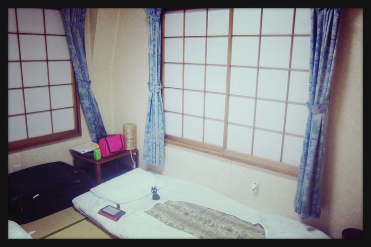 When I first saw the room, the word simple came into my mind. There were no beds. It has tatami flooring, and two thin mats with pillow sets. There were only a few of furniture; a small table in the corner and a night lamp on it, another small table with a flat screen TV on it .