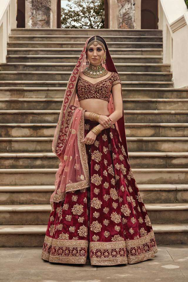Sabyasachi bridal lehenga in red and gold