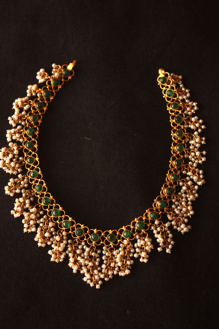 Beautiful reversible neklace with emeralds and pearls and rubies on the reverse Mahendra jewellery house Vijayawada - 520002