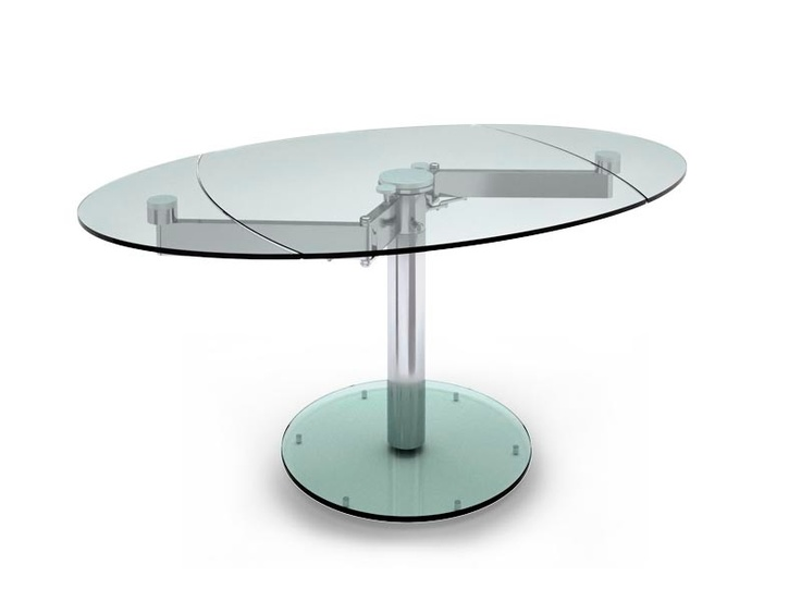 Extendable table with chromed metal frame and tempered clear glass top: very elegant!