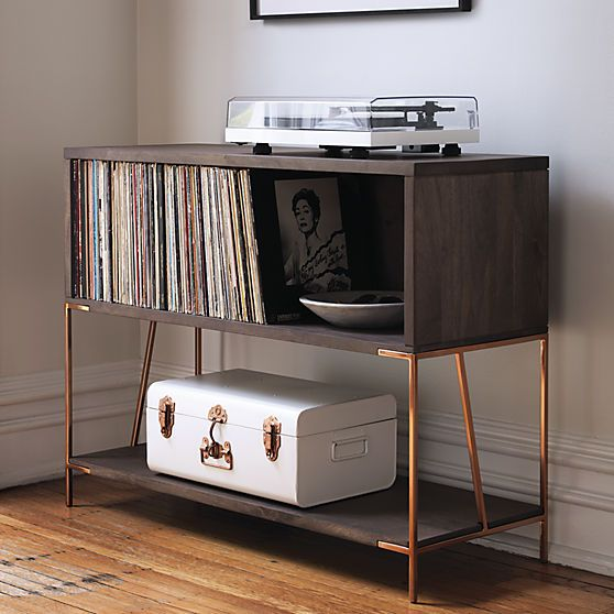 record holder.  Literally, because it's designed to hold LPs.  Figuratively, because it's possibly the best looking console in the biz.  Sleek and architectural, rich mango wood sits on shiny copper legs that are all rock and roll.  Designed by Zak Rose to have more than just looks, console opens a cubby for record storage and a lower shelf for overflow.  Pop the turntable on top and you're ready to party.