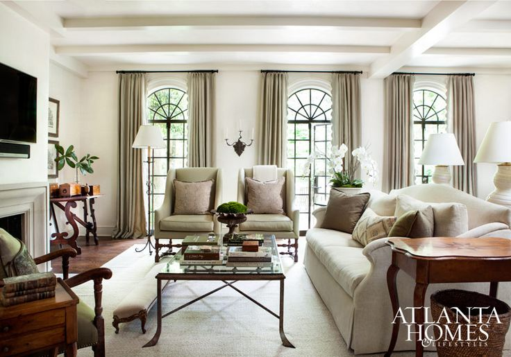 I love the arched iron doors & the soft color palette of this Buckhead Townhome.