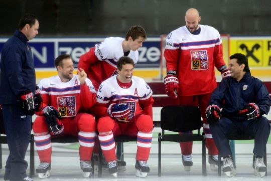Team Czech Republic preparing to pose for a team photo.