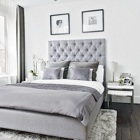 An upholstered bed and luxurious soft furnishings give this simple bedroom an air of opulence...