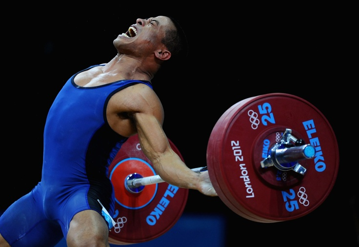 Manuel Minginfel of Federated States of Micronesia competes in the Men's 62kg Weightlifting