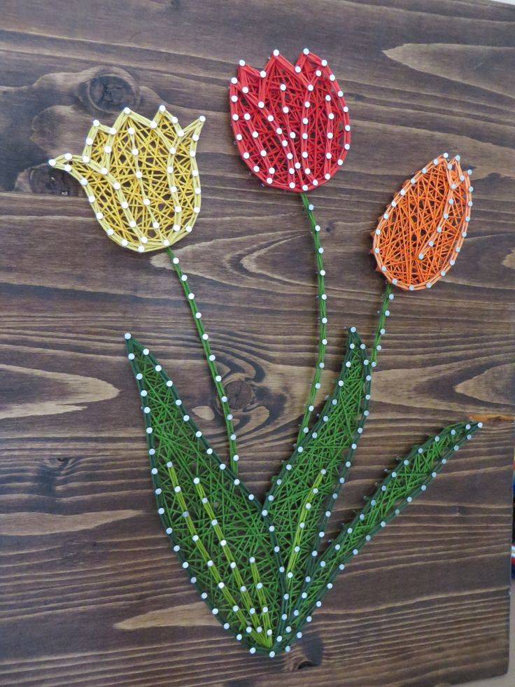 String Art DIY Kit. Yellow, Red, and Orange Tulips. Home Decor. Flower Decor. Tulip Decor. DIY Decor. DIY Crafts String Art Crafts. Click on the picture to find out more about how you can make this DIY String Art Tulip yourself