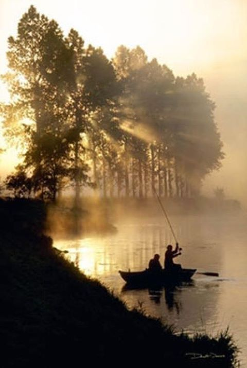 At the dawning of the day with a fishing buddy, fishing rod, and boat...On the lake looking for the big catch.
