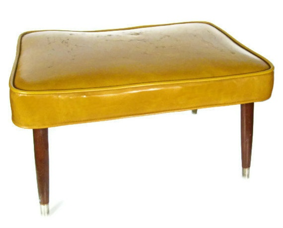 vintage mustard yellow ottoman foot stool. $48.00, via Etsy.