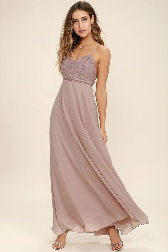 Steal the show as well as a couple smooches in the Stealing Kisses Mauve Lace Maxi Dress! Elegant lace covers a triangle bodice (with princess seams) supported by adjustable, skinny straps. A band of satin accents the waist above a flowing, chiffon maxi skirt. Hidden back zipper/clasp.