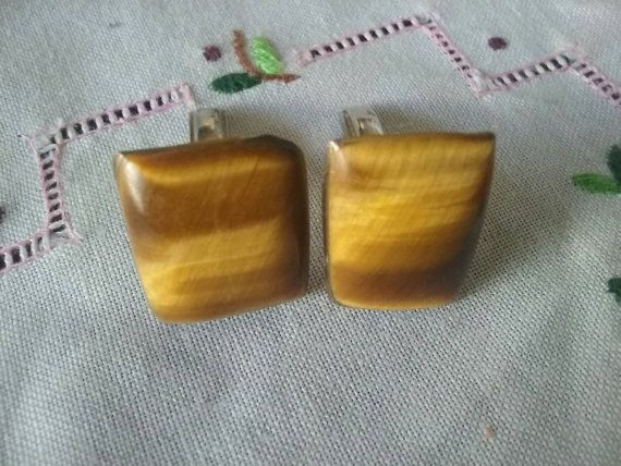 Check out this item in my Etsy shop https://www.etsy.com/au/listing/496289935/tiger-eye-cufflinks-70s