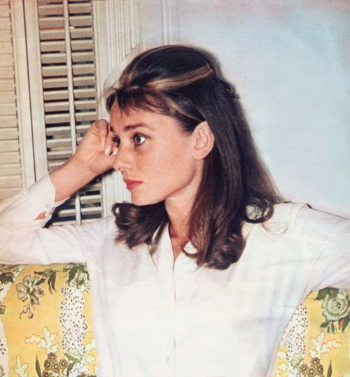 1961: Audrey takes a break during the filming of Breakfast At Tiffany's. The caramel blonde streaks added to her brown hair for the part of Holly Golightly were considered revolutionary for the time - still very prevalent in hair today - and Audrey enjoyed having them so much she decided to keep them off screen as well.