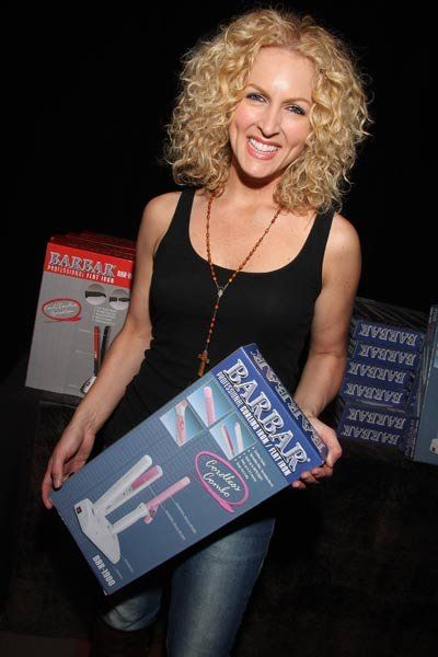 Kimberly Schlapman Of Little Big Town Holds Flat And
