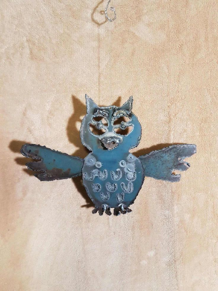 A personal favorite from my Etsy shop https://www.etsy.com/ca/listing/496982151/owl-ornament-angel-art-design-co-ow17
