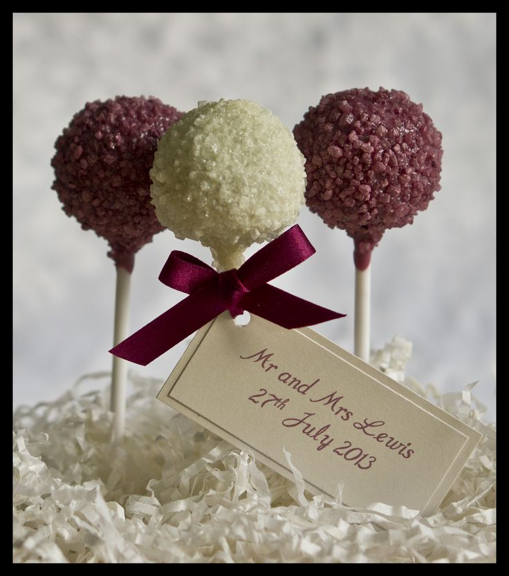 Wedding favour cake pops in burgundy and ivory