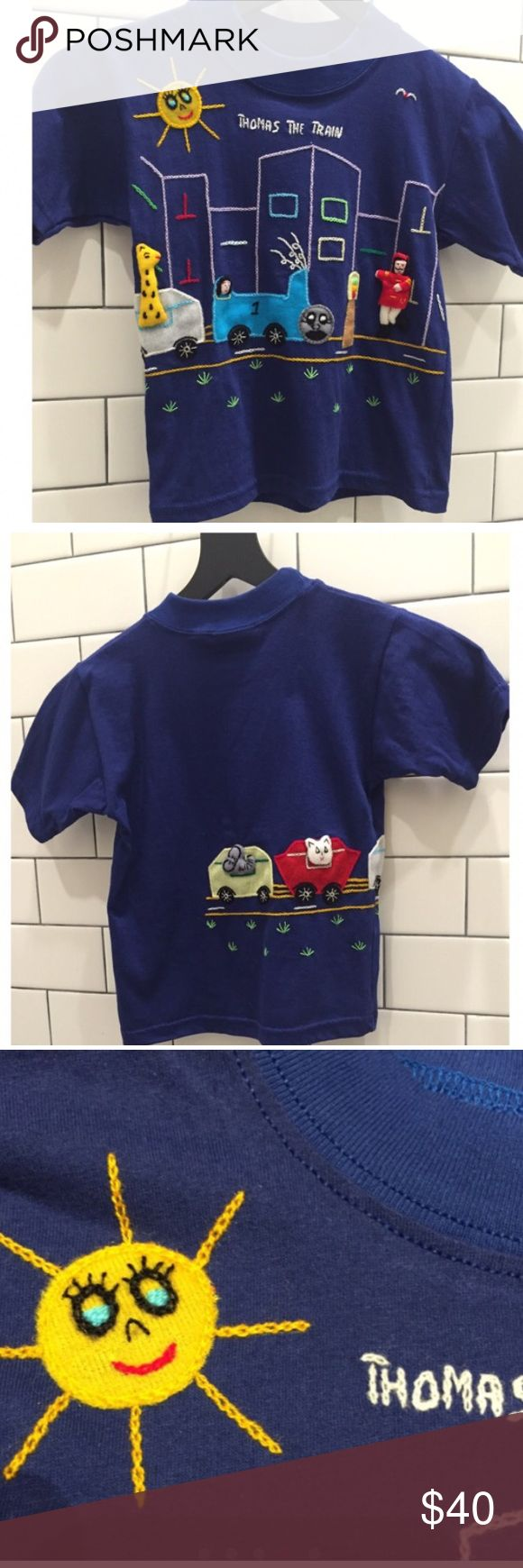 3D Hand Embroidered Thomas The Train T Shirt 4T Adorable 3D Hand Embroidered & Very Detailed Thomas The Train T Shirt Size 4T,  NEW WITHOUT TAG, Shirt is navy blue. Machine washable & dryer safe, 100% cotton, From a smoke free home. Made by: Fairy Tales On Parade By Judy! Discount On Kids Clothes When Bundled! 😎 Fairy Tales On Parade Shirts & Tops Tees - Short Sleeve