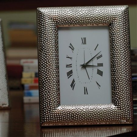 Hammer Sterling Silver Clock: Ornate white clock with sterling silver border is the perfect décor accessory for the home.