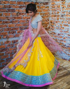 Sangeet Lehengas - Pastel Blue and Yellow Lehenga | WedMeGood Anushree Reddy creates this elegant yellow lehenga adding a pastel blue sequins and pink border, with a pastel blue sequins blouse and a net pink dupatta! #wedmegood #anushreereddy #sangeet #lehengas