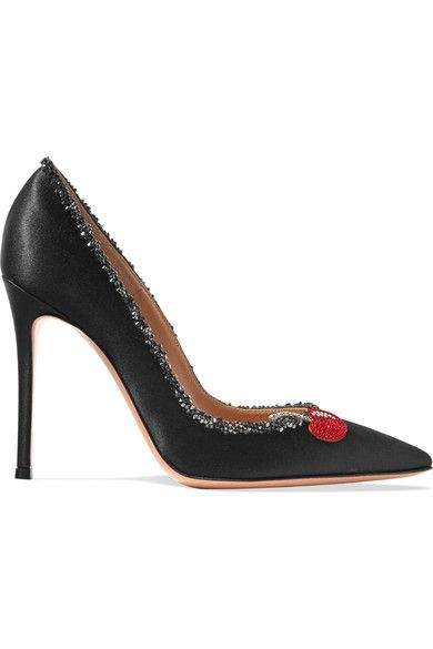 Gianvito Rossi's black pumps have been hand-finished in Italy from lustrous satin. This pair is topped with a red and silver leather cherry appliqué illuminated by shimmering crystals. Call out the subtle color accents with a same-tone shirt.