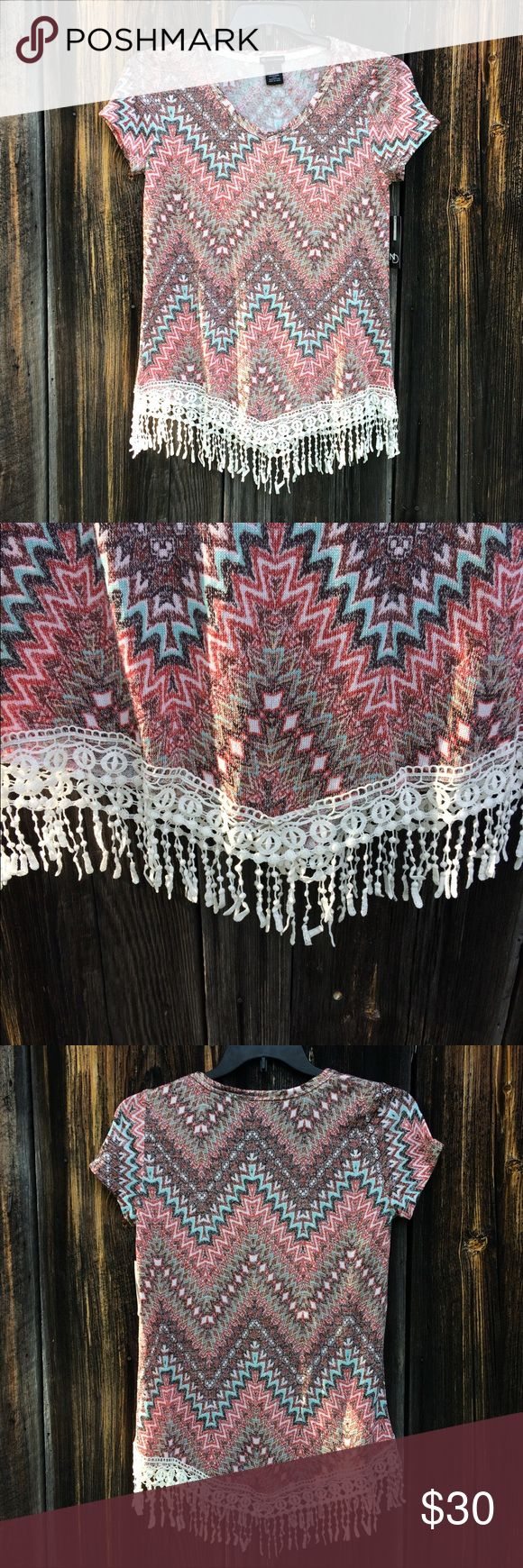 New Directions Aztec Print Lace Fringe Blouse Top Beautiful Aztec print blouse with gorgeous lace embellishment at the bottom.   This blouse would be perfect paired with black business pants and heels for a business-casual look, or leggings or shorts for a casual & comfy look! Brown, tan, teal & pink in color   **Size S but seems to be made with extra room Never worn. Comes with original tags** New Directions Tops Blouses