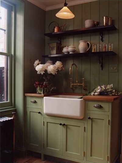 Prim Distressed Green Kitchen Cabinet...with farmhouse sink & shelving.