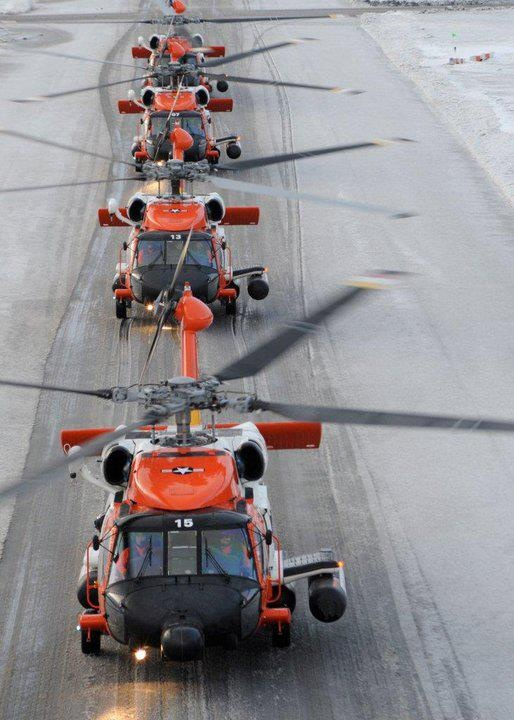 KODIAK, Alaska - The four MH-60 Jayhawk rescue helicopters attached to Air Station Kodiak taxi down the Coast Guard base taxiway in preparation for a formation flight Wednesday, Dec. 2, 2009, in 17 mph winds with snow squalls and temperatures in the 30s. Formation flights trains general aircraft handling skills as well as skills that aircrews use when conducting multi-ship vertical insertion operations of Maritime Safety and Security Team boarding teams.