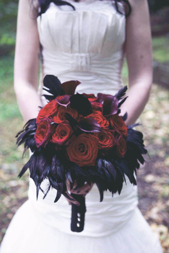 A Darkly Dramatic Gothic Wedding  I like this a lot, but with blue instead of red.