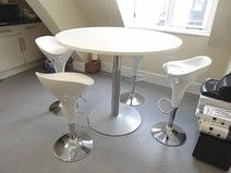 Height-adjustable white top meeting/breakout table in first class condition.