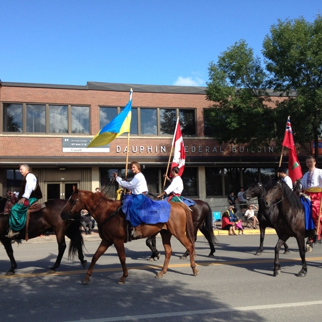 08/03 Dauphin's Ukrainian Festival begins with a downtown prade led off by Cassocks ...