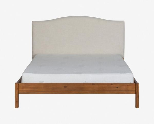 An equal mix of contemporary and industrial chic styles, the Petra bed is a smart addition for transitional spaces. The durable frame is crafted from wood for a timeless look and the headboard is upholstered in linen adding a layer of softness to the aesthetic.   Queen bed pictured.  MATERIALS: Solid Acacia or Soiid Ash, Solid Poplar Slats,Linen, Polyester FINISH: Natural Acacia or Light Grey