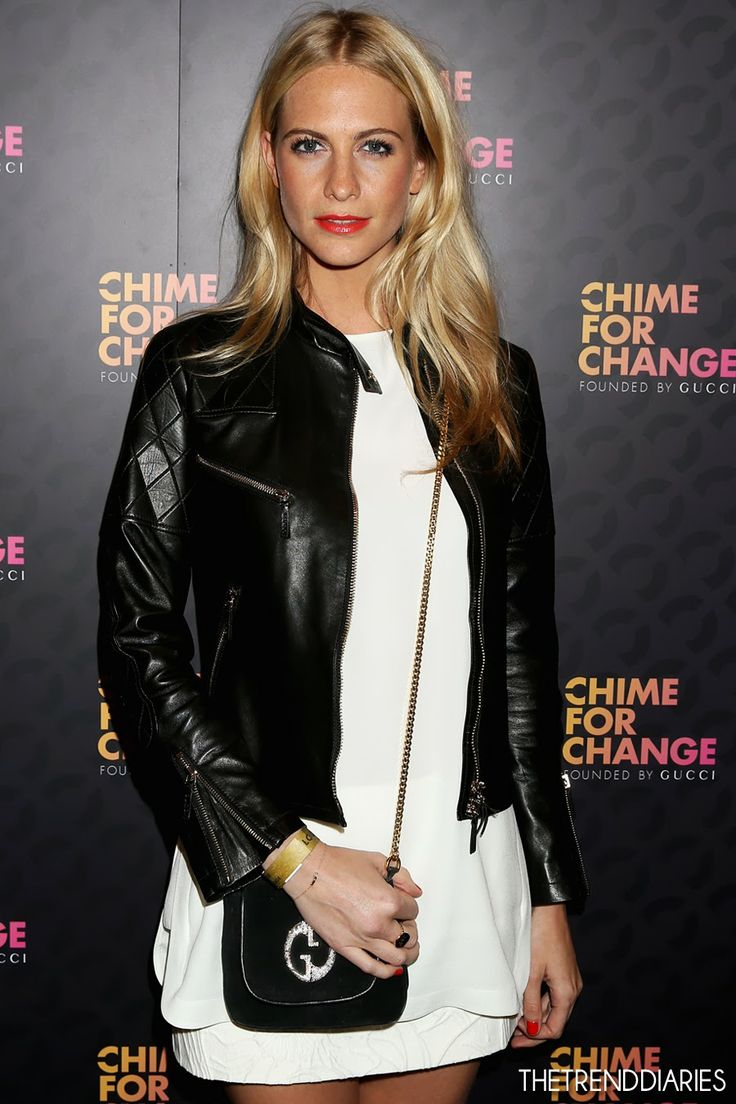 Poppy Delevingne. I like the orangey red lips + biker ...