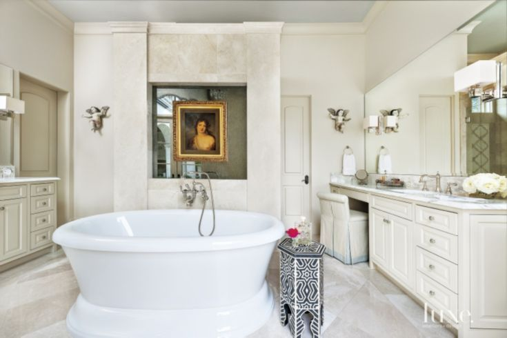 Mediterranean Cream Marble Master Bath with the beautiful @BainUltra Balneo Naos freestanding bathtub. Learn more about this #therapeutic #tub here : http://bainultra.com/therapeutic-baths/our-collections/balneo/naos-6636